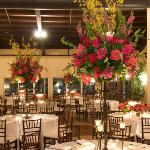 orchid,roses,bells of ireland centerpieces perla farms wedding flowers.
